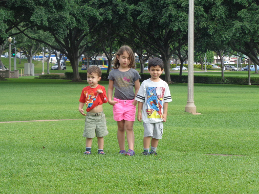 Three kids in a park - unhappy