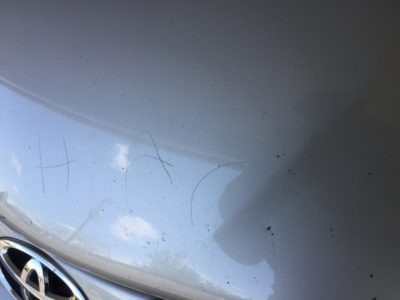 harry's name etched in car