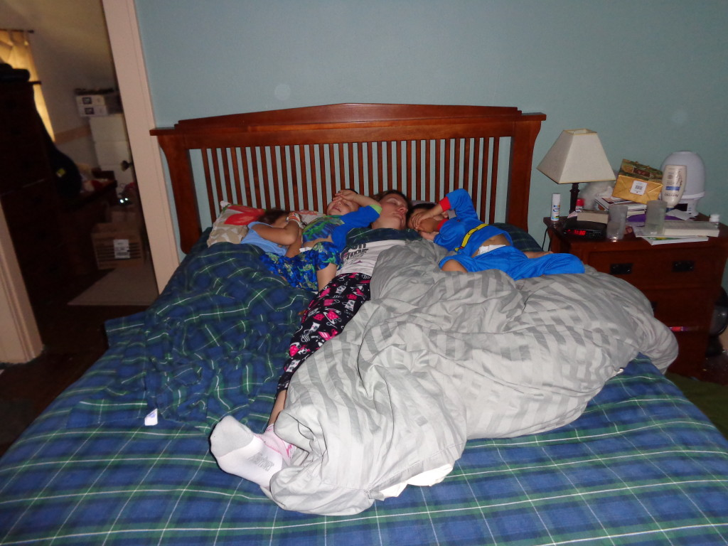 Mick, Lilliana, Bennett, and Harrison sleeping in our bed