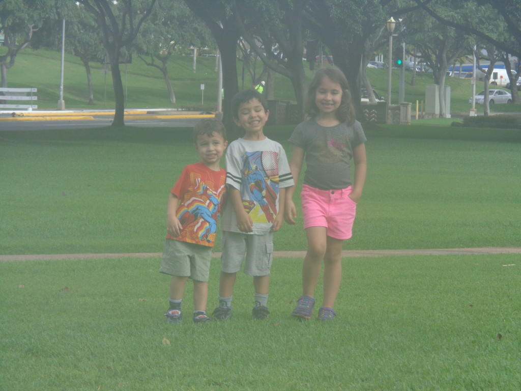 Three kids in a park - happy